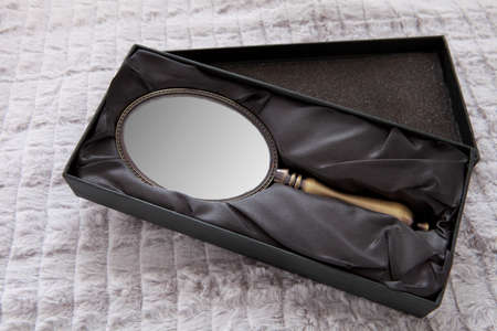 Hand mirror in the box