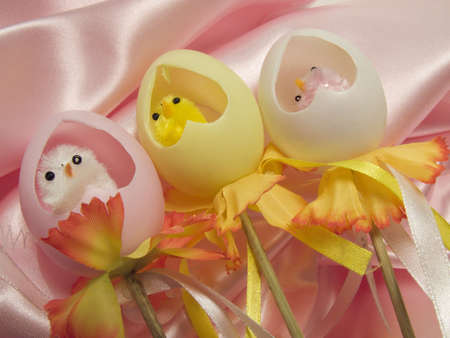 Chicks inside plastic and colorful eggs as surprises for easter holidays photo