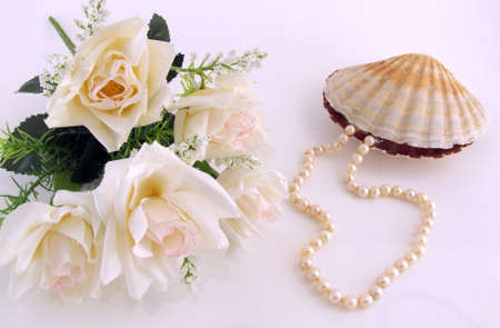 A pearl necklace going out from a shell