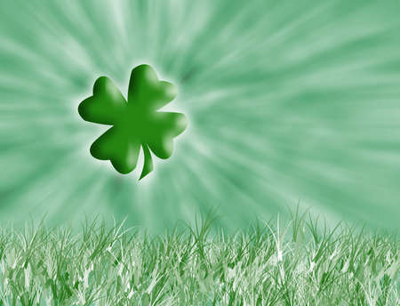 Four leaf clover with grass and a green background  photo