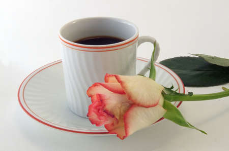 A cup of hot coffee with a rose as decoration on a white background Stock Photo - 861054