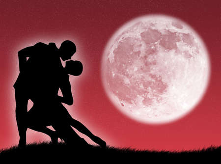 sexual couple: Couple dancing a tango in the moonlight