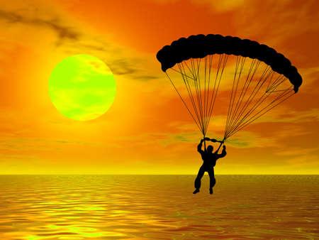 色鮮やかな夕焼けに対してシルエットで落下傘兵 写真素材