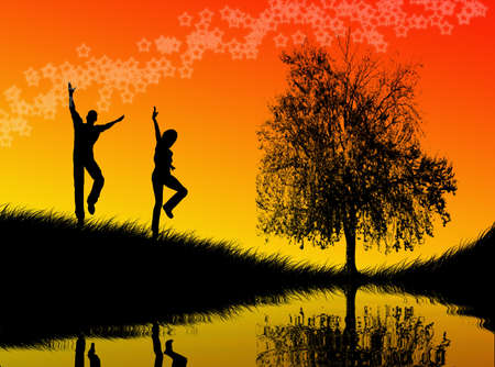 Black man and woman figures jumping in the sunset Stock Photo - 3103394