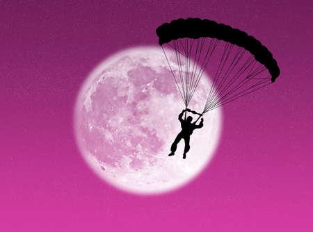 Parachutist in silhouette against a brilliant moon Stock Photo - 3683549