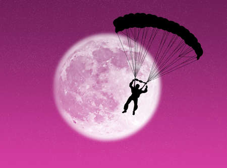 Parachutist in silhouette against a brilliant moon Stock Photo - 3683549