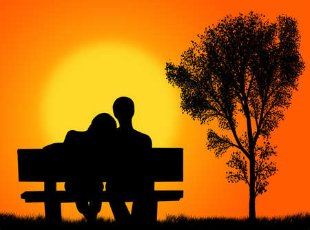 Lovers on the bench in front of a colorful sunset