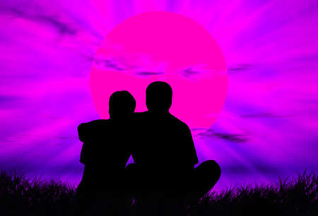 infatuation: Lovers on the grass in front of the sunset Stock Photo