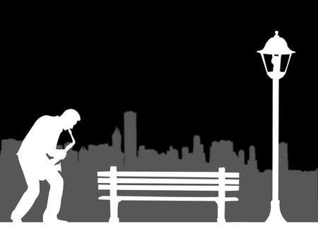 サックス奏者、街灯の下で都市の再生 写真素材