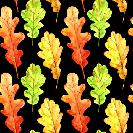 Seamless pattern with autumn oak leaves. Watercolor fallen leaves of green, orange and red with colorful drops and splashes on a black background. Template for design.