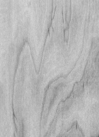 Abstract monochrome wooden background. Black and white varnished wood texture in grunge style. Close-up, top view, natural material of gray color.