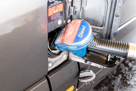 Berlin, Berlin/Germany - 12.07.2019: A diesel fuel gun in a vehicle transporter while refueling 写真素材