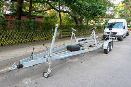 Berlin, Berlin/Germany - 06.08.2019: A boat trailer without boat, parked on a roadside or parked without towing vehicle