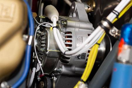 An alternator in a Cessna 180 in detail. Foto de archivo - 137985296