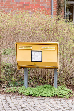 Berlin, BerlinGermany - 24.03.2019: A mailbox for wheelchair users, which was built especially low, so that wheelchair users can throw in mail without help. There are two slots on the mailbox, one for urban and one for out-of-town use.