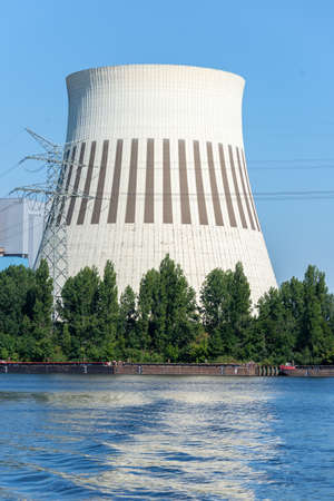 A cooling tower used to cool down hot water in power plants or industrial plants. Only water vapour escapes from these towers.