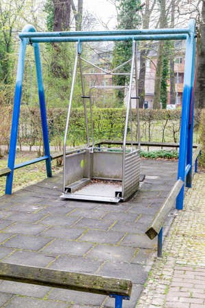 Berlin, BerlinGermany - 24.03.2019:A metal swing for wheelchair users, on which they can swing with a wheelchair, that is for disabled people.