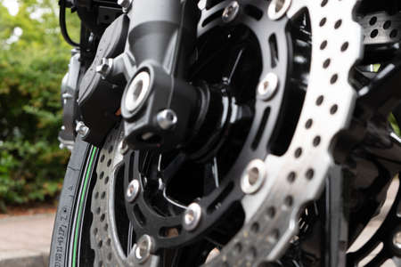 Berlin, Berlin/Germany - 16.07.2019: The disc brake of a motorcycle in close-up with brake disc, brake caliper and wheel hub