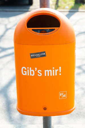 Berlin, Berlin  Germany - 23.03.2019: A garbage can of the BSR (Berliner Stadtreinigung) in orange with the inscription Editorial