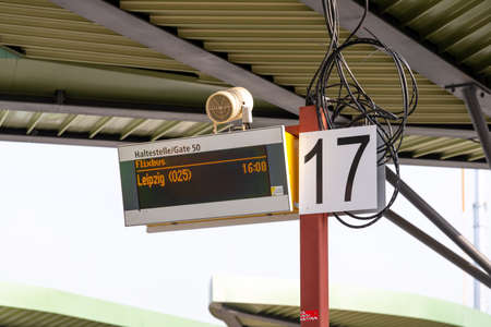 Berlin, BerlinGermany - 24.03.2019: A digital departure indicator to a bus station in Berlin with loose cables and the departure to Leipzig in the waiting area