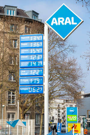 Berlin, Berlin/Germany - 24.03.2019: The price mast of an Aral petrol station with prices in blue and white, with the prices and a lot of advertising in the background in a city.