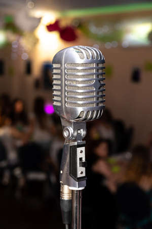 Nostalgic microphone on a stage in a hall with an event