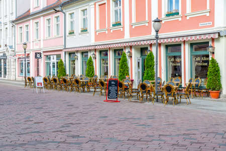 Potsdam, Brandenburg / Germany - 24.03.2019: A street caf? ? in Potsdam, photographed from the front, without guests with chairs and tables in front of the caf? ?.