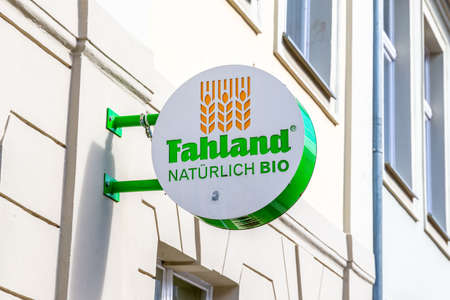 Potsdam, Brandenburg / Germany - March 24th, 2019: A sign on a house fa?ade of the Fahrland Bio Bakery with green lettering and logo. Redakční