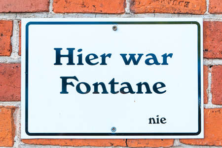 Neuruppin, Brandenburg/Germany - 25.07.2019: A sign on a brick wall on which stands: Here was Fontane..... never, because in Neuruppin there is a sign on every corner that Fontane was here. Redakční