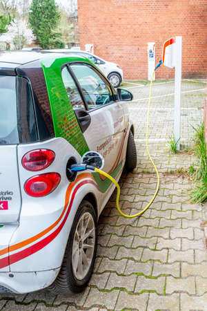 Berlin, Berlin/Germany - 24.03.2019: An electric car Smart, which is charged at a charging station by means of a cable. Redakční