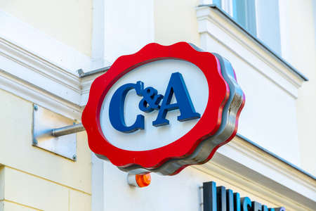 Potsdam, Brandenburg/Germany - 24.03.2019: The logo of C&A, a specialist clothing store on a house wall in red and blue Redakční