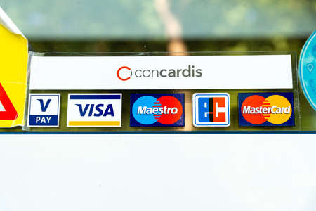 Berlin, Berlin/Germany - 03.09.2019: A sticker on a glass pane with logos of different credit cards showing the payment option. Sajtókép