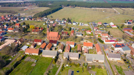 Paaren am Glien, Brandenburg/Germany - 26.03,2020: The village Paaren Glien in Brandenburg photographed from the air with the village church in the middle and individual farms