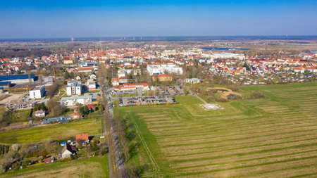 Nauen, Brandenburg/Germany - 26.03,2020: The city of Nauen photographed from the air with the hospital Havellandklinik and the helicopter landing pad in the centre of the picture.