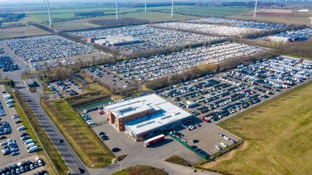 Ketzin, Brandenburg/Germany - 26.03,2020: The premises of the company Mosolf in Ketzin Brandenburg with thousands of vehicles stored on the site photographed from the air.