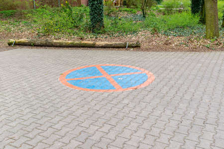 A painted parking prohibition on a paved area, which is already slightly faded and means that parking or holding on the area is not allowed. Stock Photo
