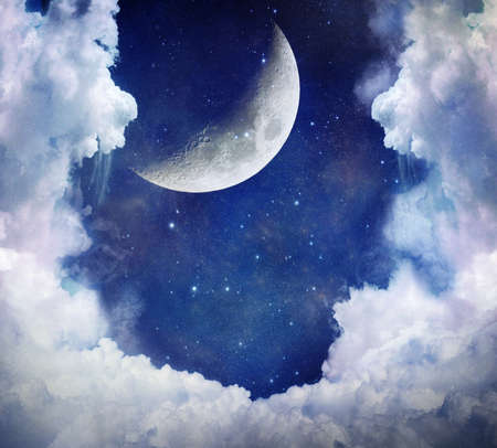 Moon in a blue and clouded sky