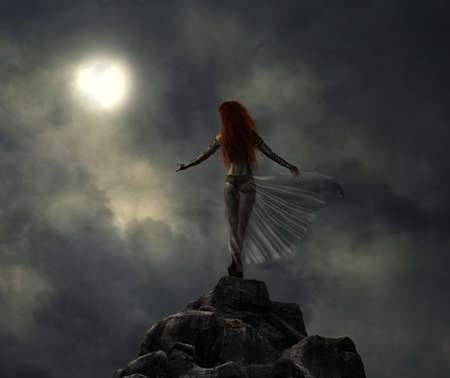 Warrior woman in the top of a hill looking at the moon photo