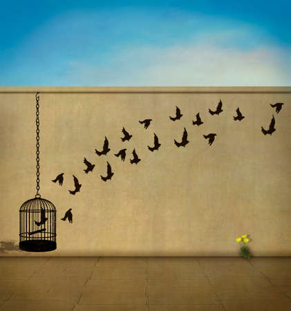 a wall with a cage and birds flying and a yellow blossom