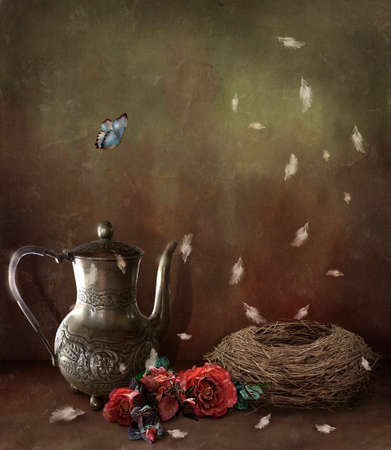 abstract decoration with nest, silver tea pot and nest. Standard-Bild