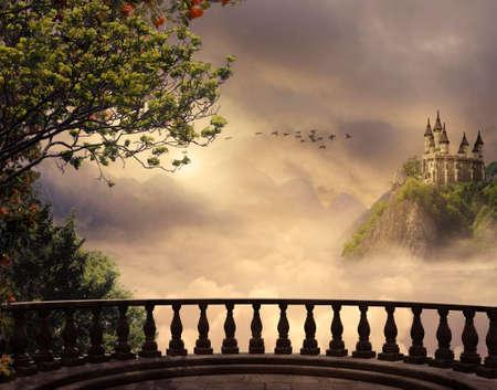 Vista desde un balcón de un castillo en la cima de la montaña en un día hermoso Foto de archivo - 74613673