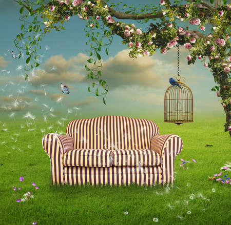 Flowered tree with roses and ivy in a field with a sofa and a cage