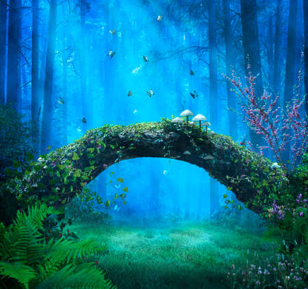 Magic forest at night and rays of light illuminating blue butterflies and fallen trunk