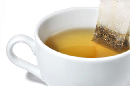 tea bag steeped in a white cup