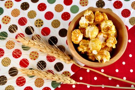 tritium: Popcorn close up with ear barley on background Stock Photo