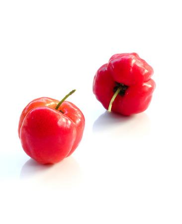 Acerolafruchtabschluß oben auf Hintergrund Standard-Bild