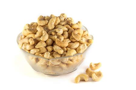 cashews: Lots of cashews in transparent dishware
