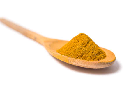 curcuma: Milled curcuma on wooden spoon