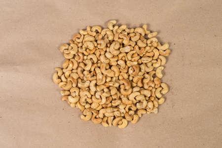 cashews: Roasted cashews on paper Stock Photo