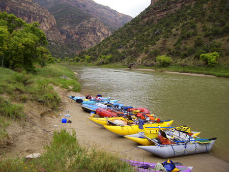 Whitewater raft camping on a summer day